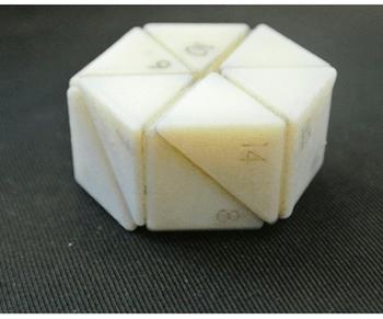 self assembling bricks create an object in a spinning chamber