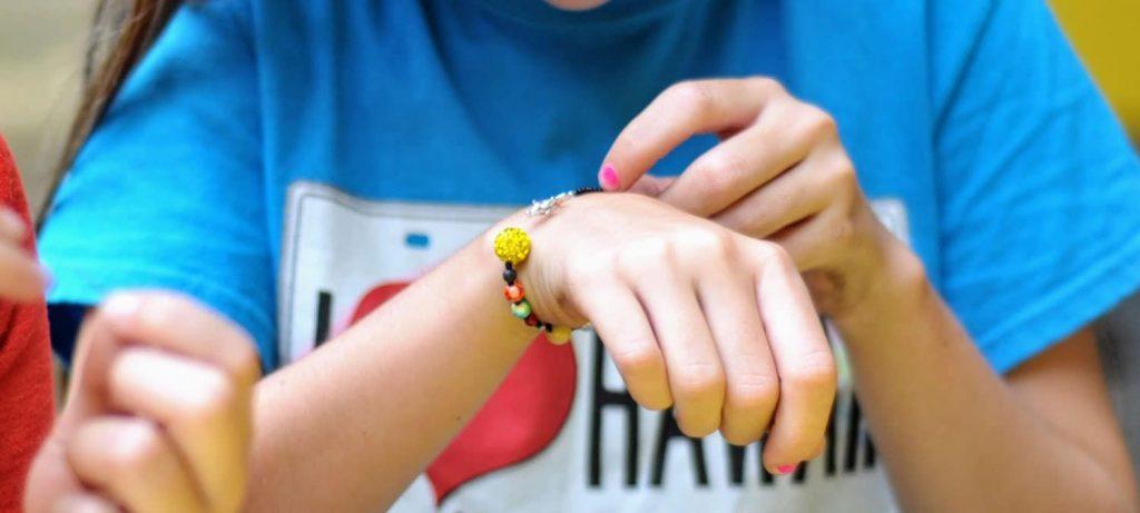 solar system bracelet on girls hand
