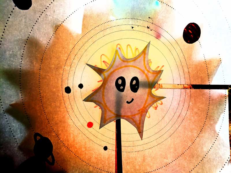 close up of sun from LED solar system in kids circuit activity