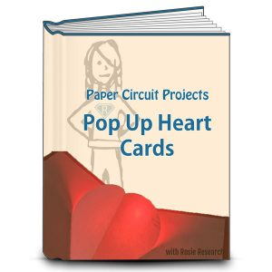 book cover with an image of a light up pop up heart card for valentines day. Text reads Paper Circuit Projects: Pop Up heart cards