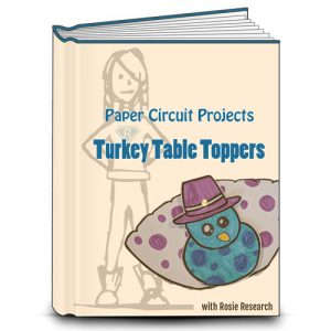 Rosie Research orange book cover with the title Paper Circuit Projects: Turkey table topper. Image of Rosie Research girl logo and a turkey table topper project with LED.