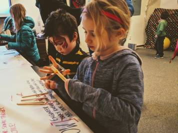 catapult design - catapults for kids in a winter activity featured