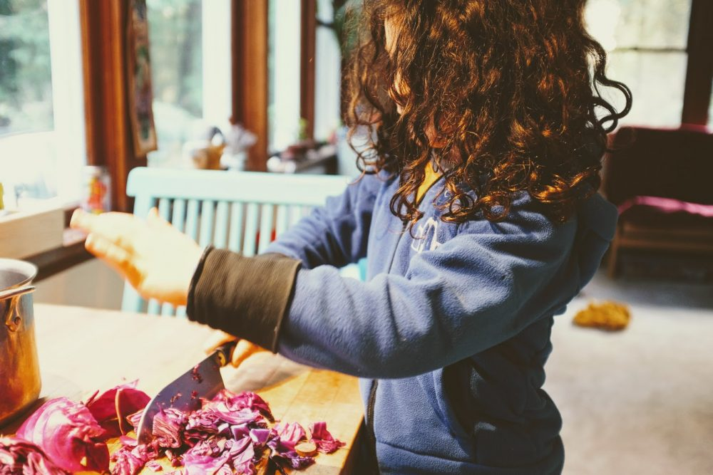 cutting purple cabbage to create a natural Easter egg dye that can change colors