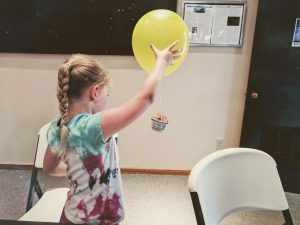 egg drop science experiment prototype girl with yellow balloon and egg basket