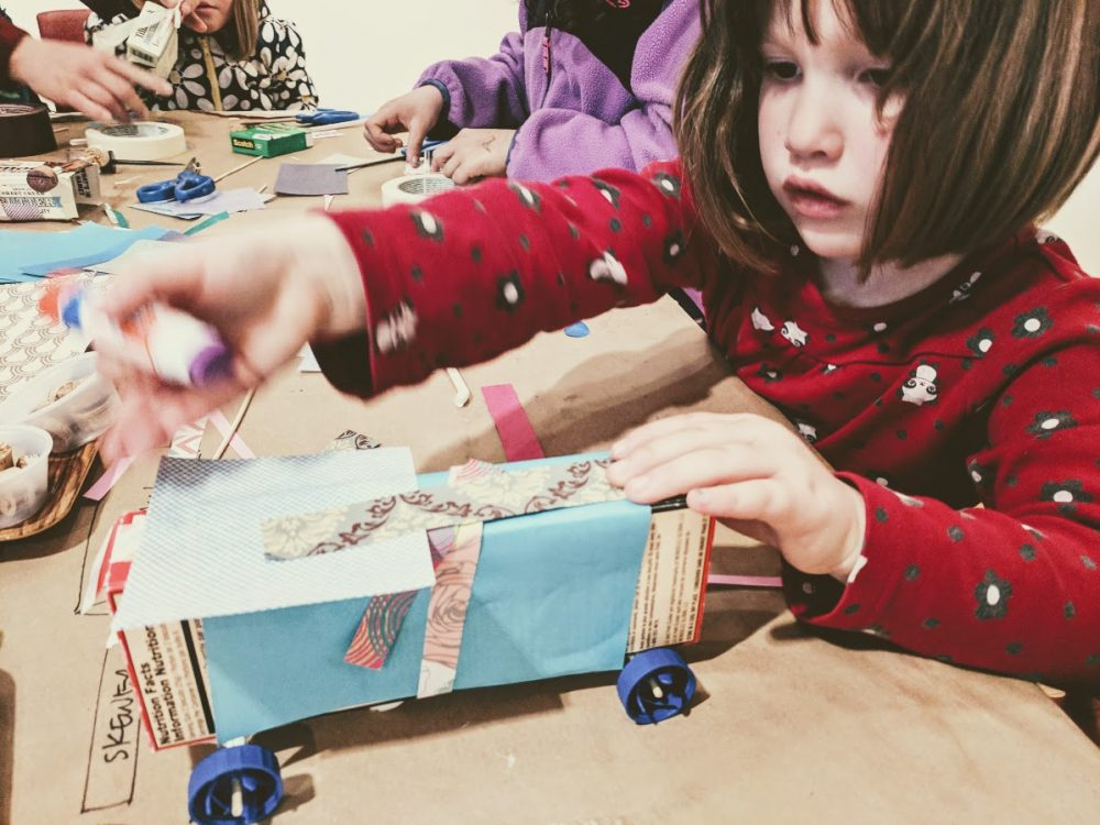 kids engineering recycled box cars