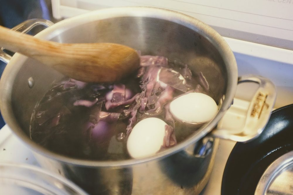 naturall easter egg dye eggs boiling with purple cabbage