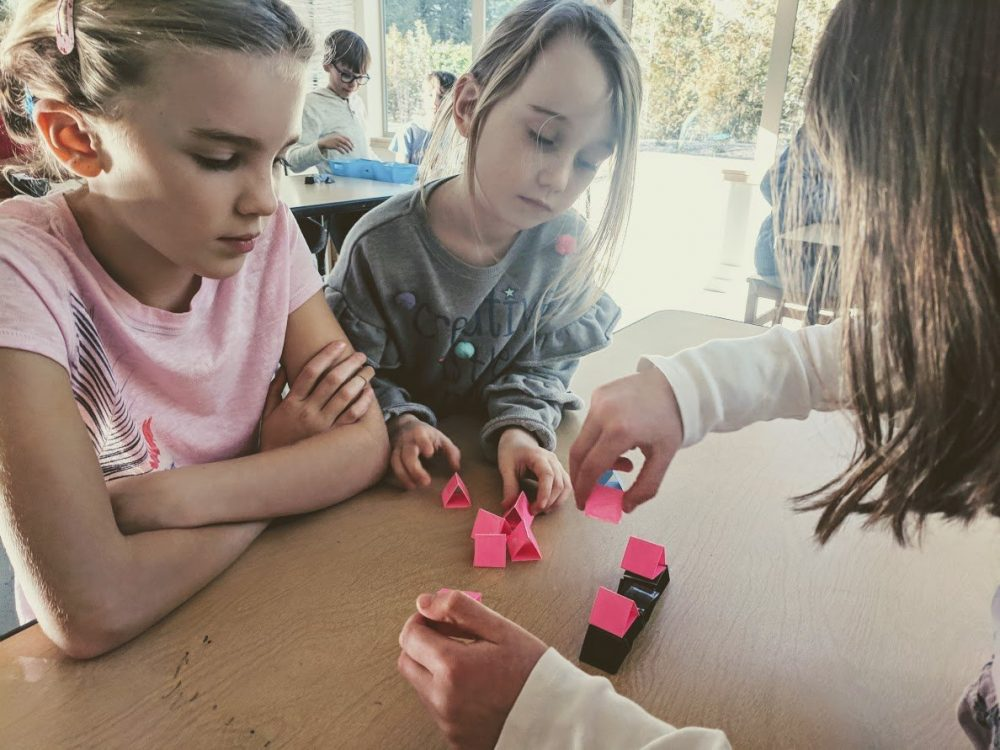 working as a group with engineering challenges on bainbridge island paper towers